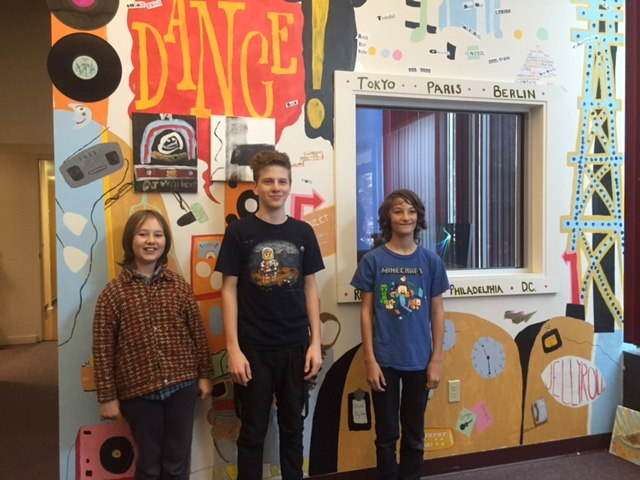 Radio & TV station mural with artists