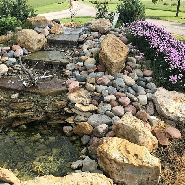 One of the beautiful water features at Mellon Acres.  The flowers smell so good!!#flowersweddings #weddings #outdoorwedding