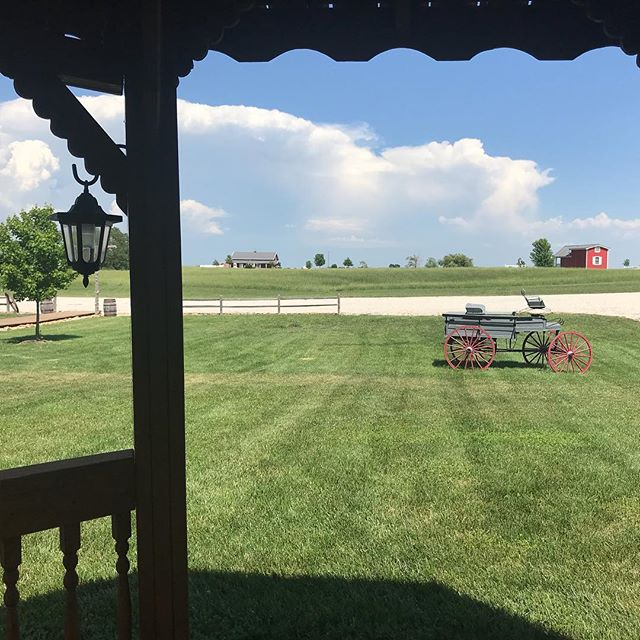 Come on rain!! Sitting in the swing at the Rustic Barn Gazebo.  What a beautiful view of the Red Barn.