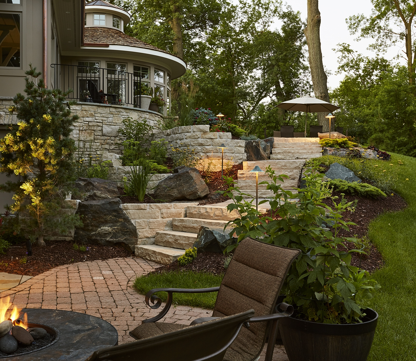 A space to sit and enjoy the fire, with a view of the beautiful landscape and Minnehaha creek.