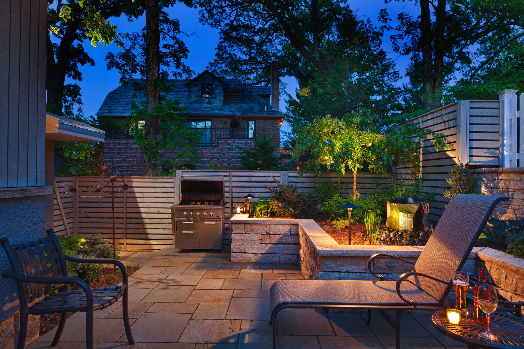 This Minneapolis backyard may be small, but it is full of wonder! Tabor Group Landscape added privacy with space to entertain and relax.