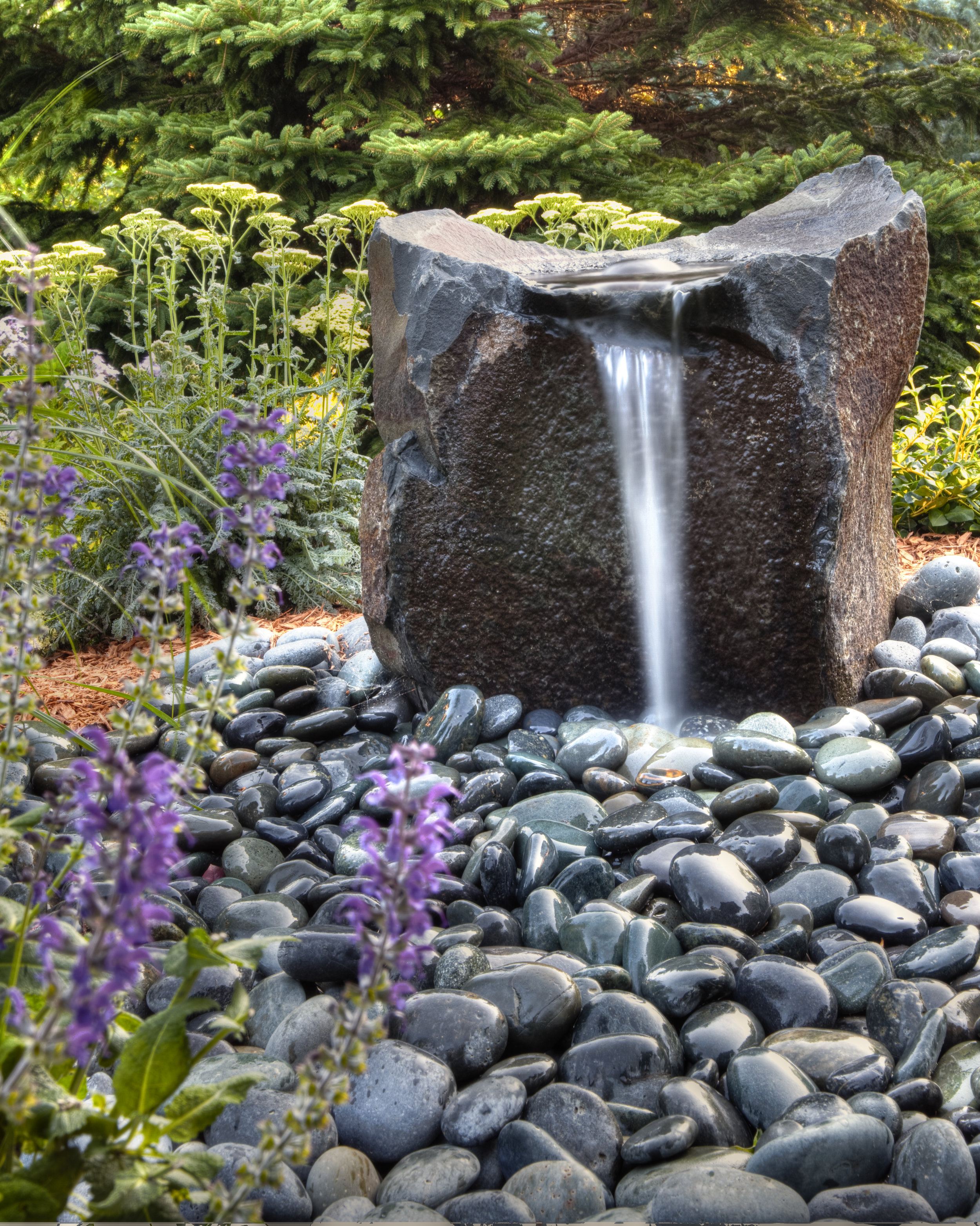 A vacation in your own backyard. The calming sound of a waterfall steps from your door.