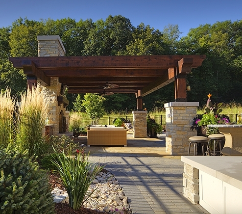medina home added a beautiful cabana looking toward the limestone rock, which includes a waterfall and low-maintenance plants for more time to spend outdoors