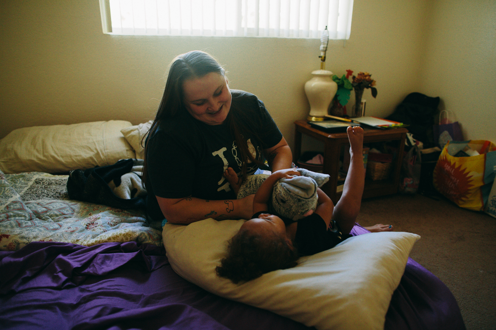 for the past couple days I'd been working on a film related to the sex trafficking problem in the fresno area.  while the sights and sounds were largely grim, there were glimmers of hope.  this is Arien, a survivor and now happy single mom playing with her 2 year old daughter in the bliss of an AC-filled room on a hot summer Sunday afternoon.