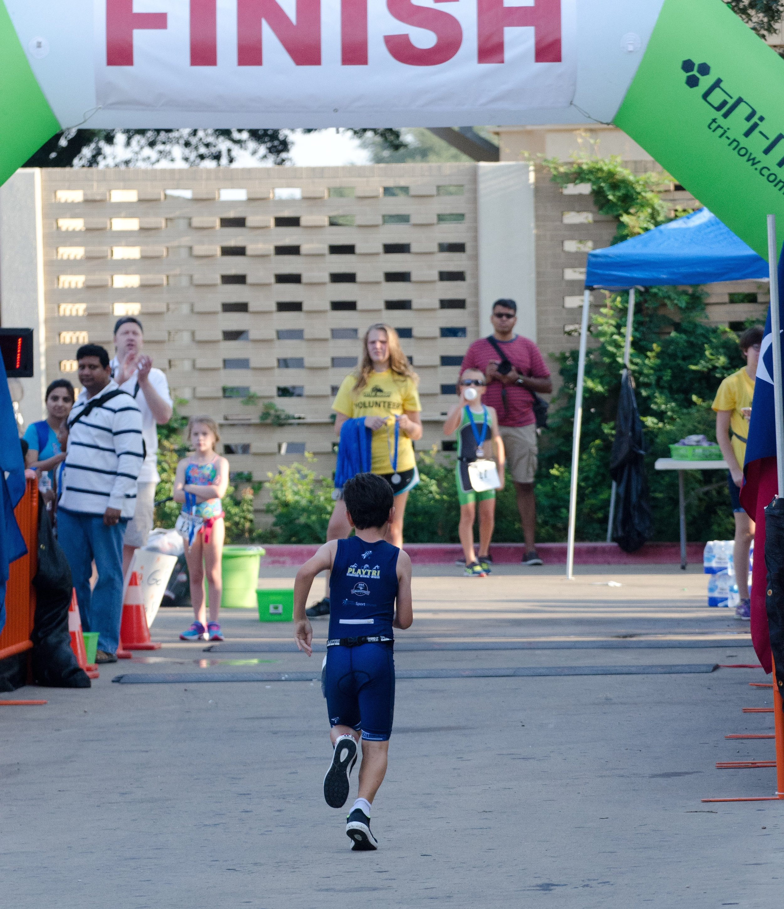 My son, Reed, crossing the finish line of his first triathlon at age 7. Athletes use awareness to stay present in the game, keep their focus and reach their goals. Photo by Jeff Wooten.