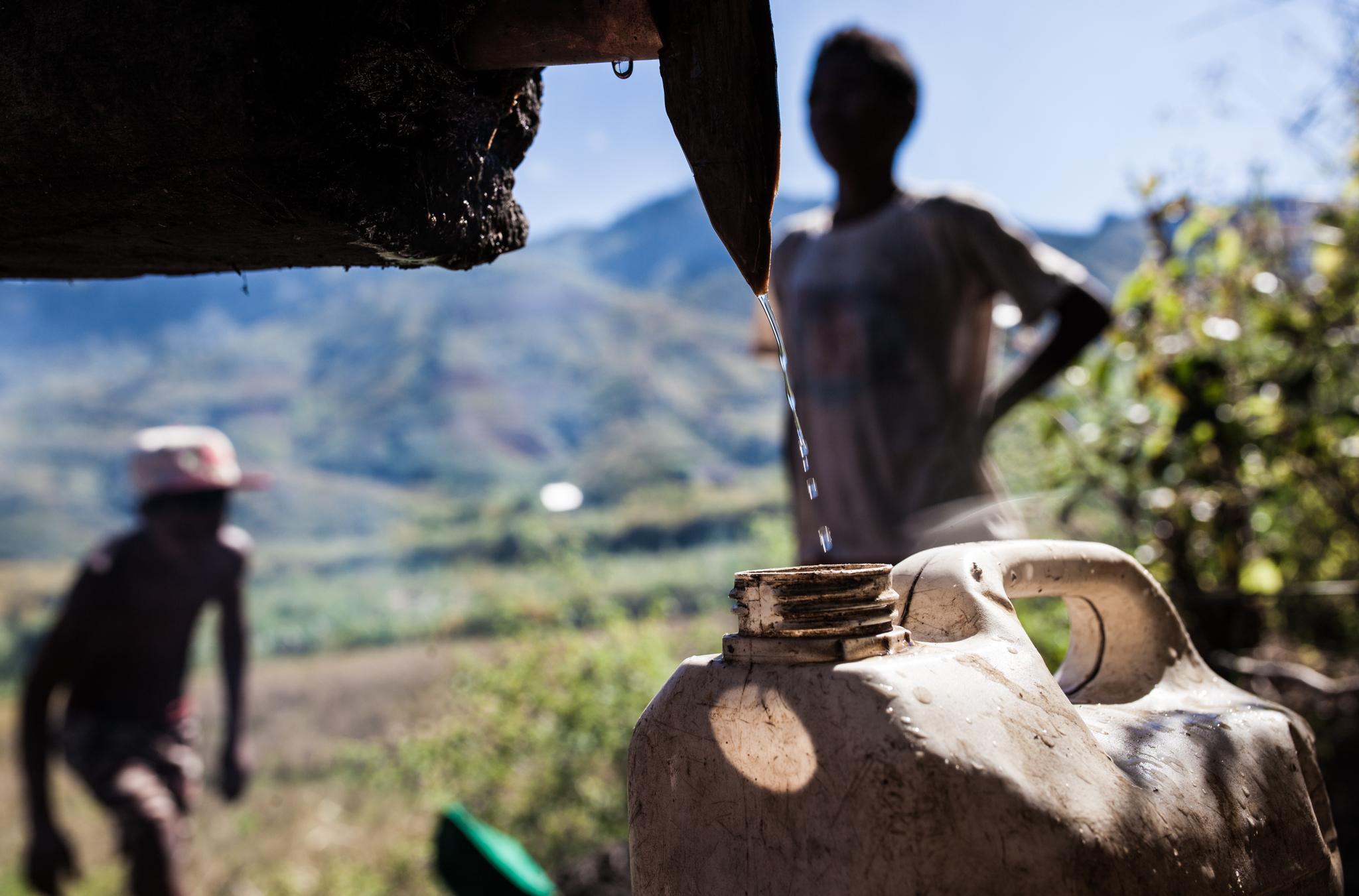 An Irrigation System from a Nearby Spring Cools the Evaporated Moonshine Which is Collected in Jerrycans