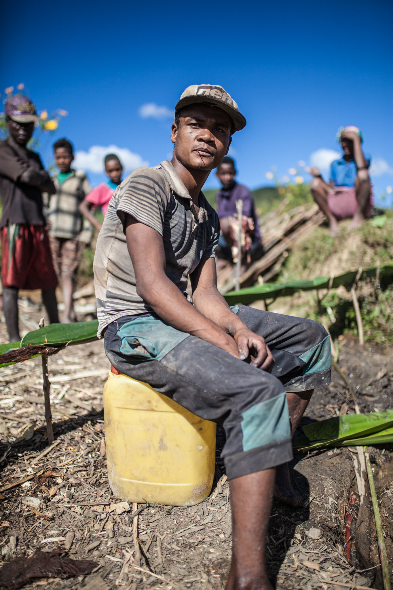 A Young Toaka Gasy Moonshiner Poses in his Distillery