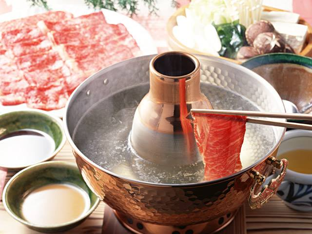 Shabu-shabu - しゃぶしゃぶis a comforting Japanese hotpot meal. Thinly sliced quality meat and fresh vegetables are gently swished and cooked in seconds in our housemade broth bubbling in the middle of your table. The name is inspired by the sound your ingredients make as they swim in your broth,