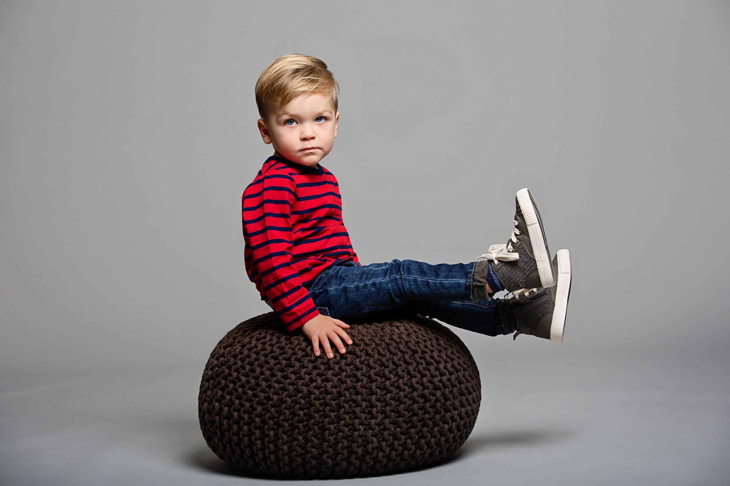 boy in studio on cushion