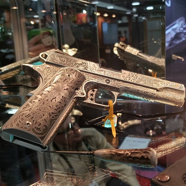 Another favorite of mine from SHOT Show. The attention to detail on this @cabotguns 1911's is just insane. Beautiful. #1911 #firearms #guns #custom #engraved #badass