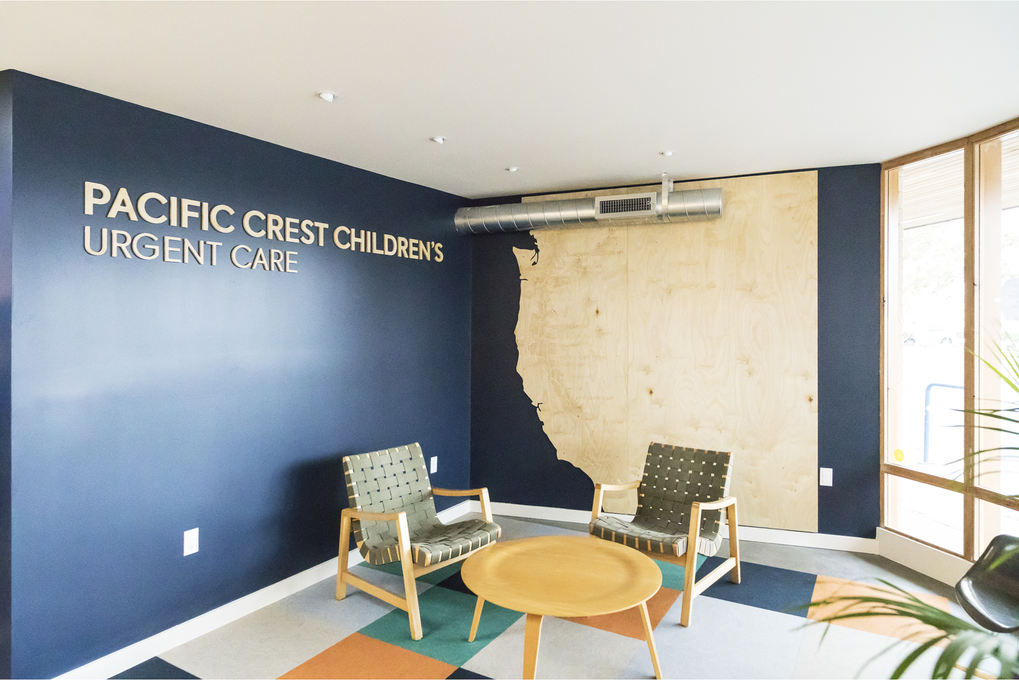 The waiting room Pacific Crest Trail wall graphic engages children to explore the trail from Canada to Mexico.