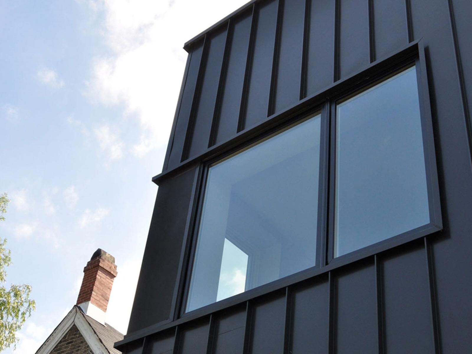 Corner windows bring light into an upstairs bedroom