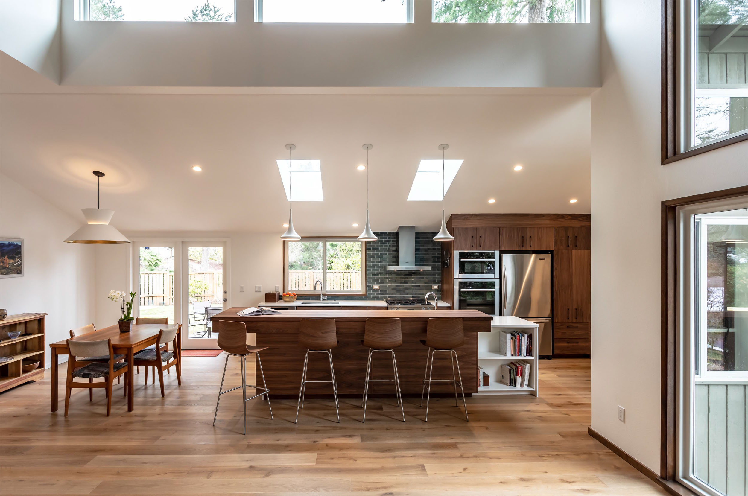 Skylights and clerestory windows flood the kitchen with natural light
