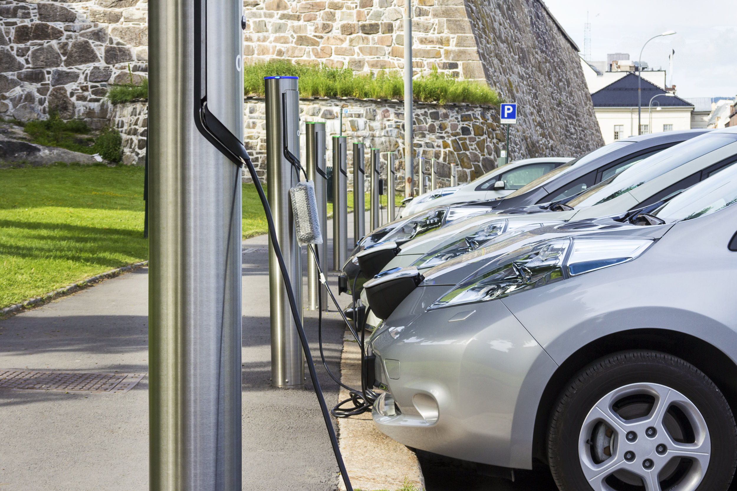 Line of electric cars charging.jpg