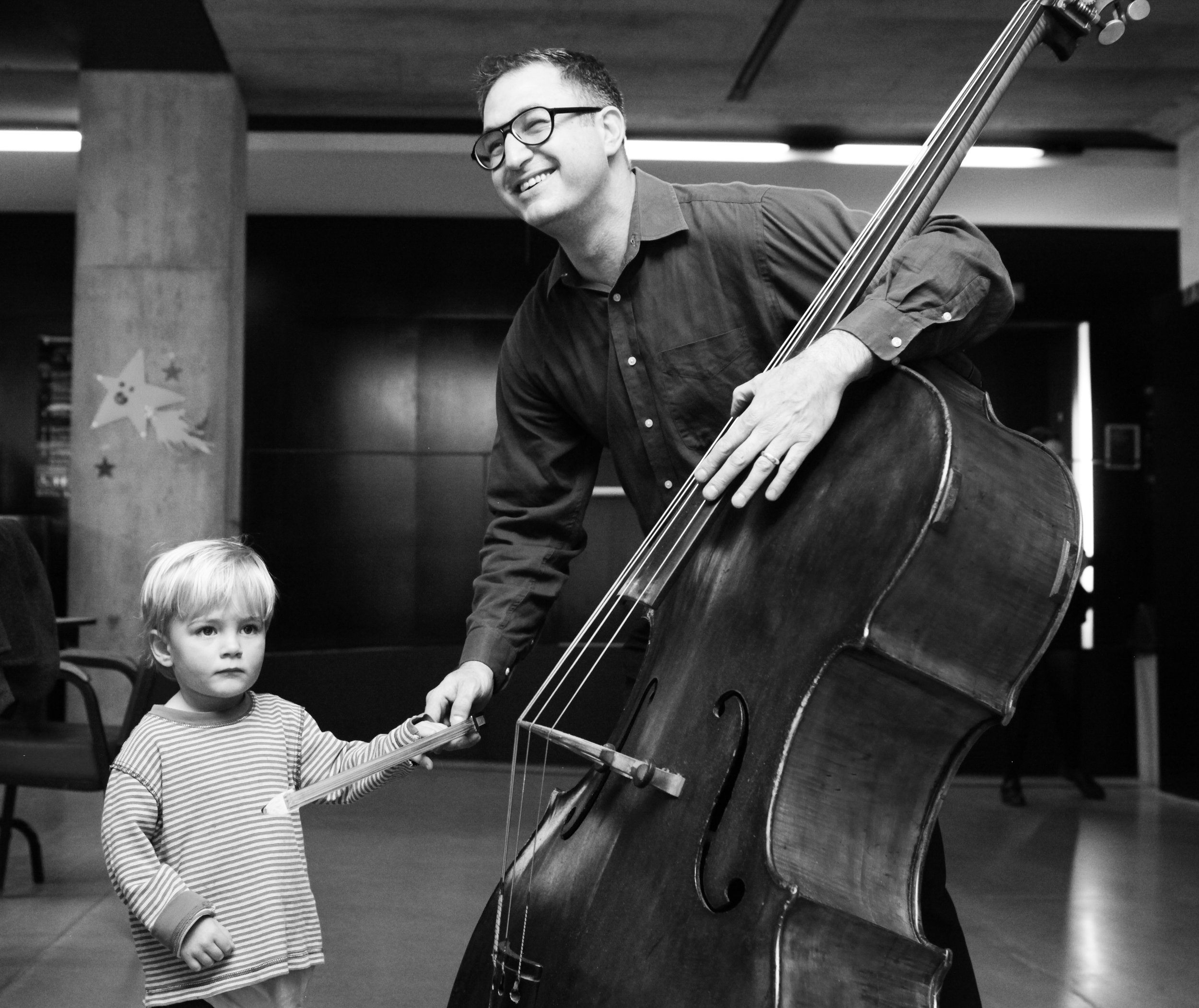 Bass Reuven with Child Playing 5.jpg