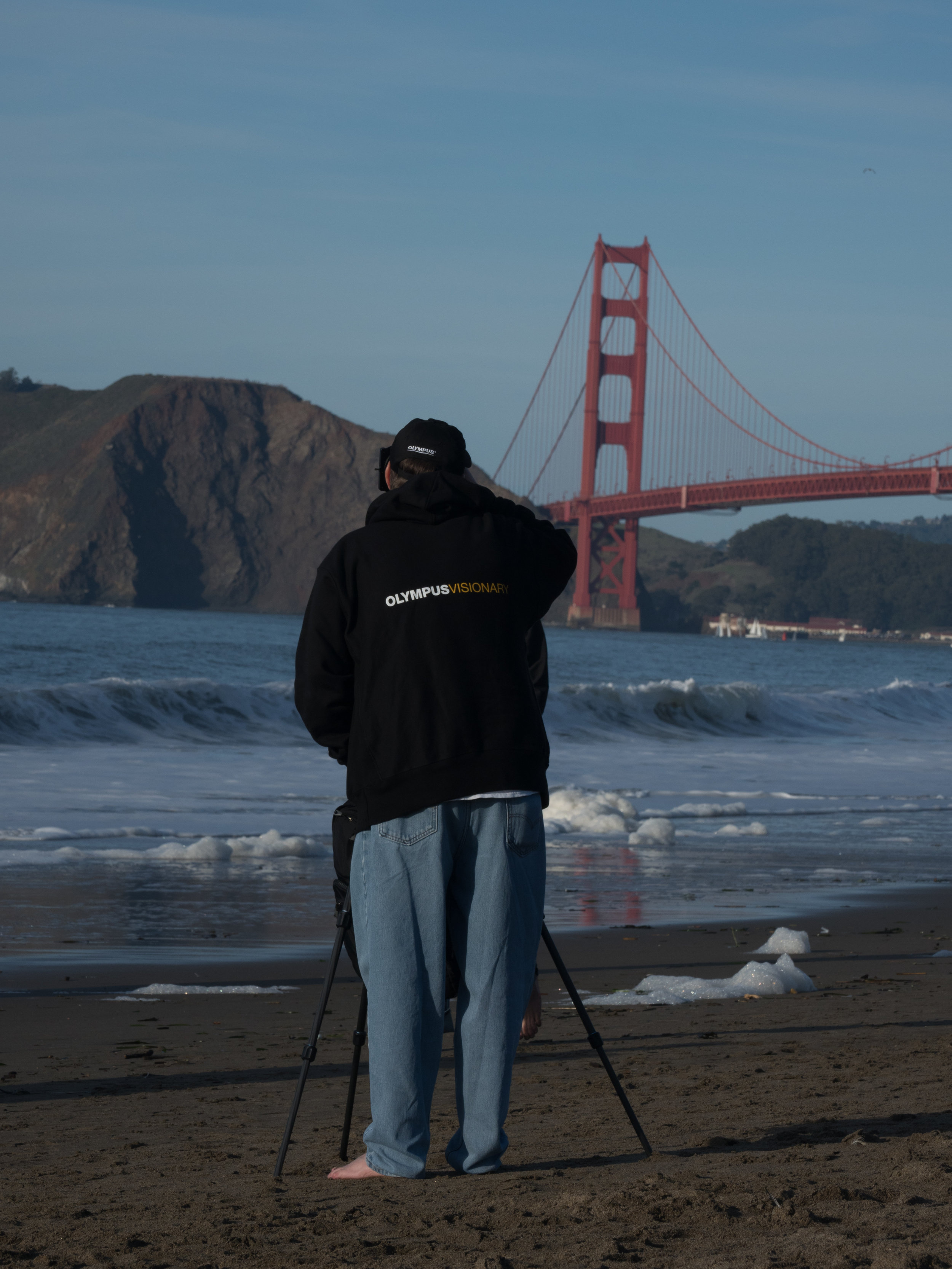Alex photographing the Golden Gate...barefoot and beachy