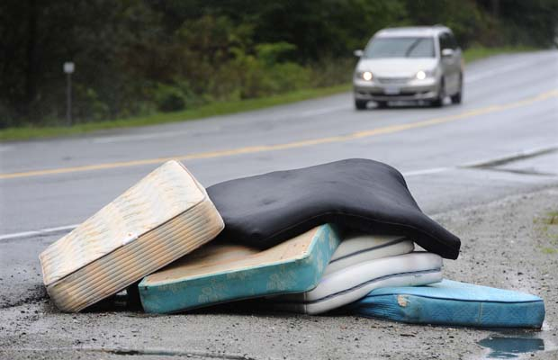 Mattresses by the side of the road.