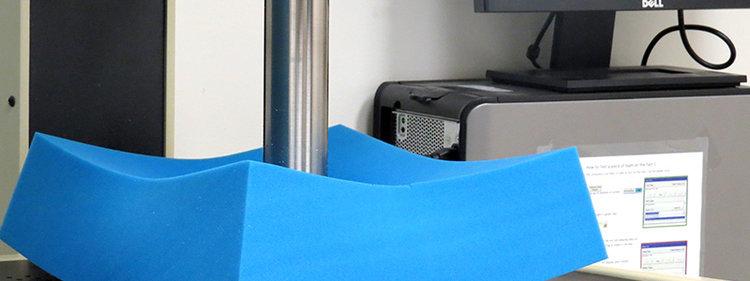 Indenter testing foam firmness for a mattress