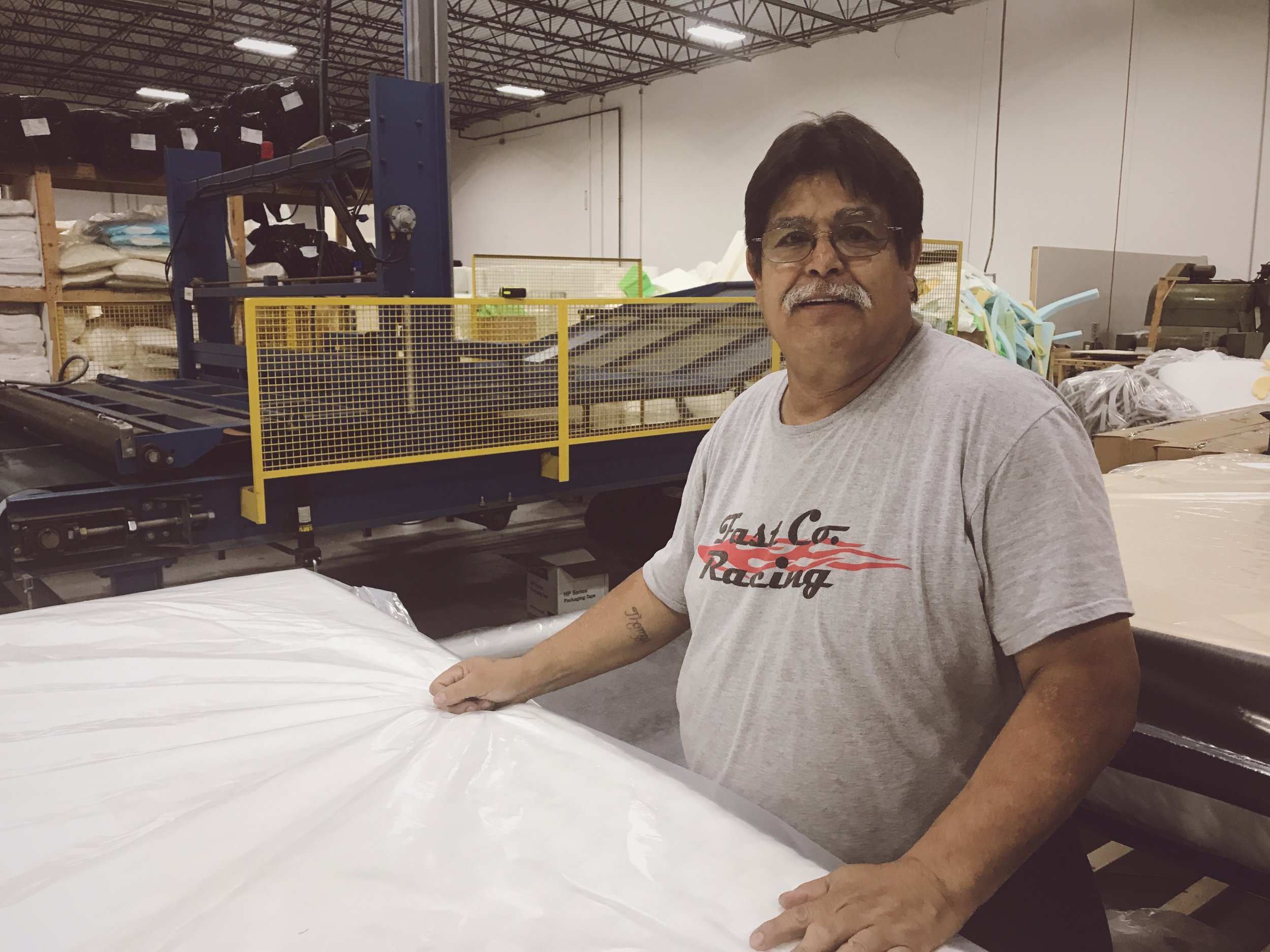 Tom Rodriguez, building mattresses at the Comfort Option headquarters in Indianapolis / Greenfield, Indiana.
