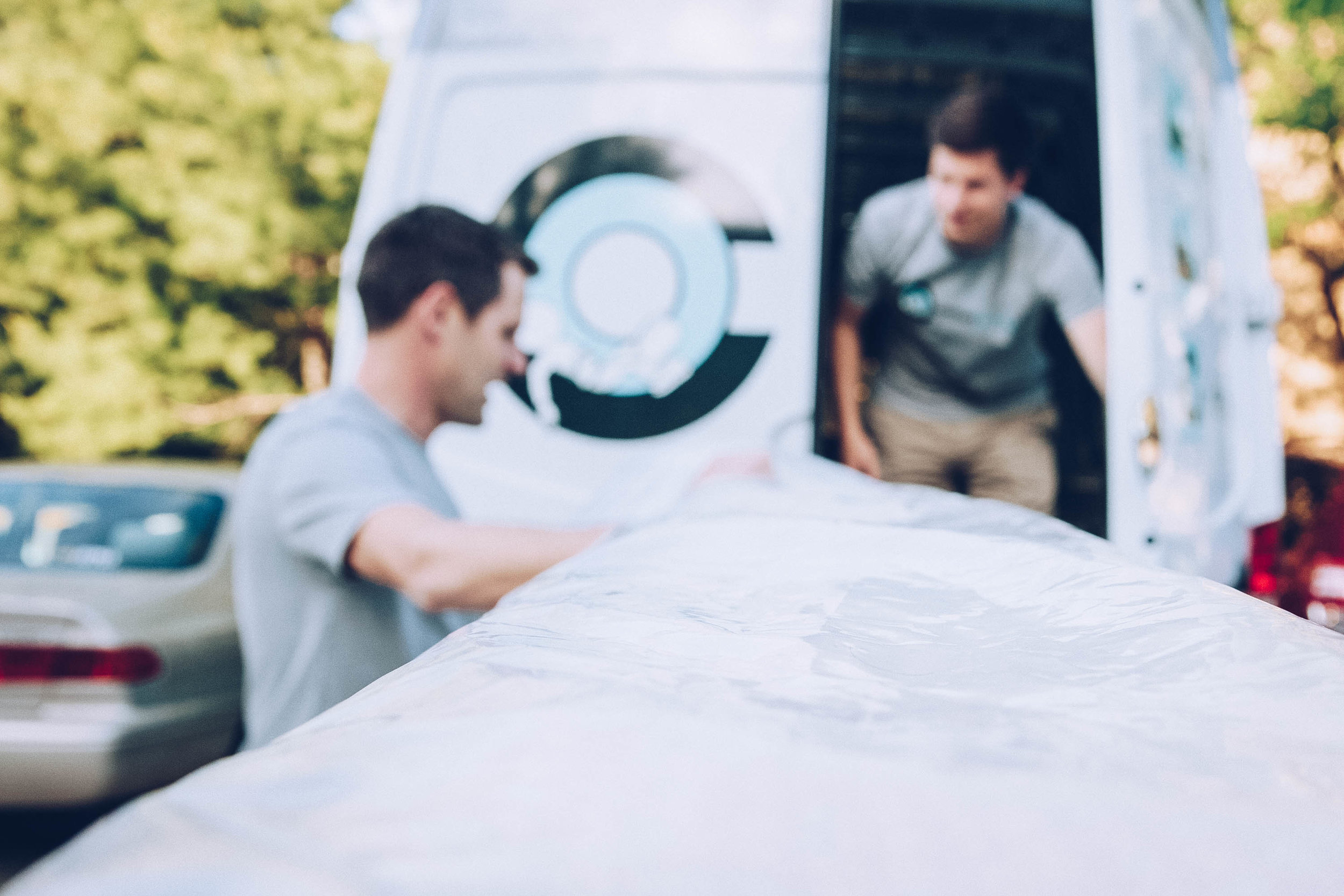 Our delivery specialists delivering a mattress to our Indianapolis neighbors.