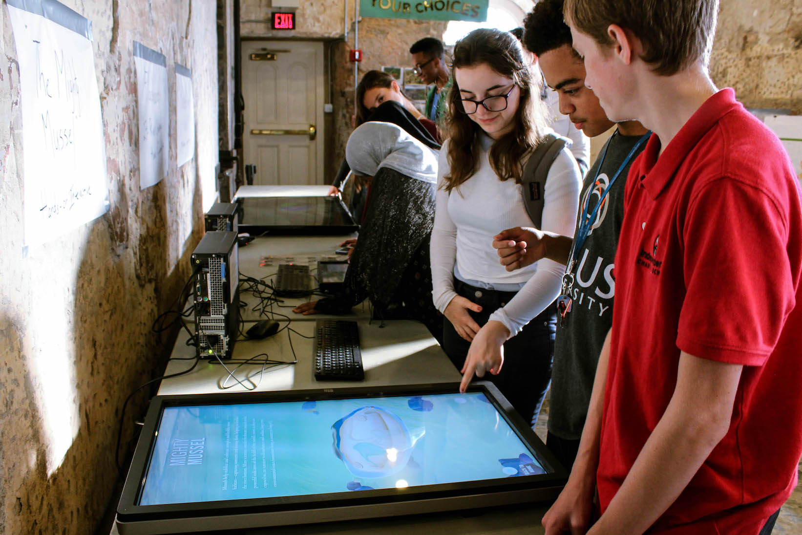 User testing interactive screens with high school students at the Mussel Hatchery.
