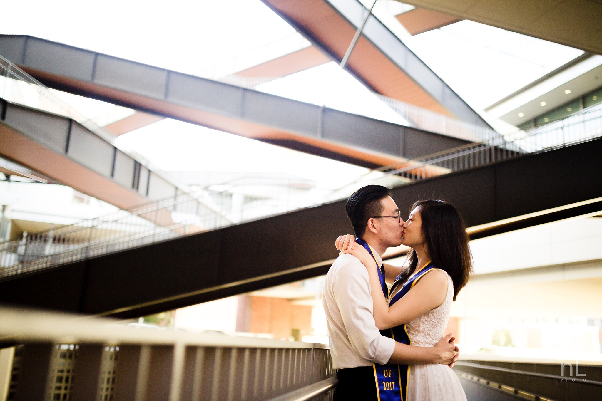 los angeles ucla senior graduation epic dramatic portrait cute architectural photo of cute couple kissing under staircases