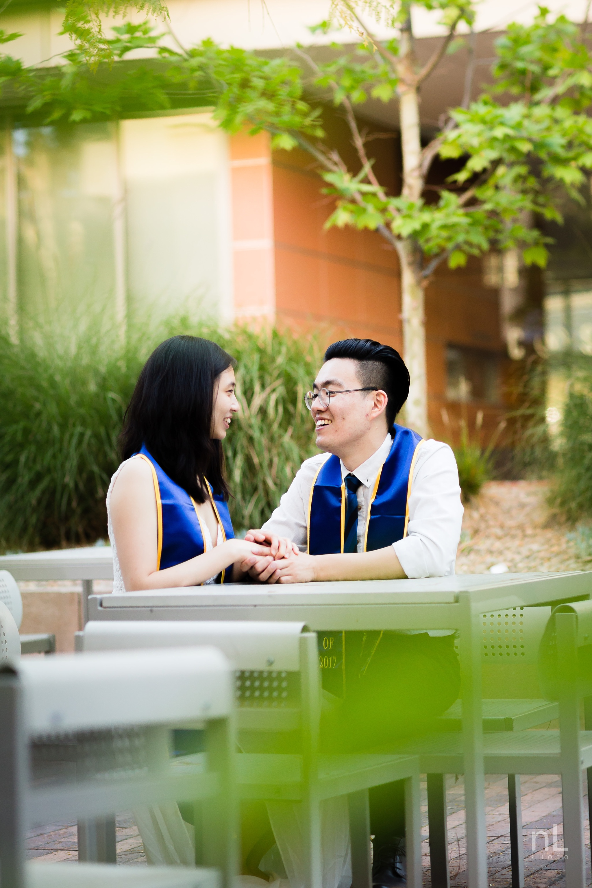 los angeles ucla senior graduation portrait cute couple laughing in bomb shelter cafe