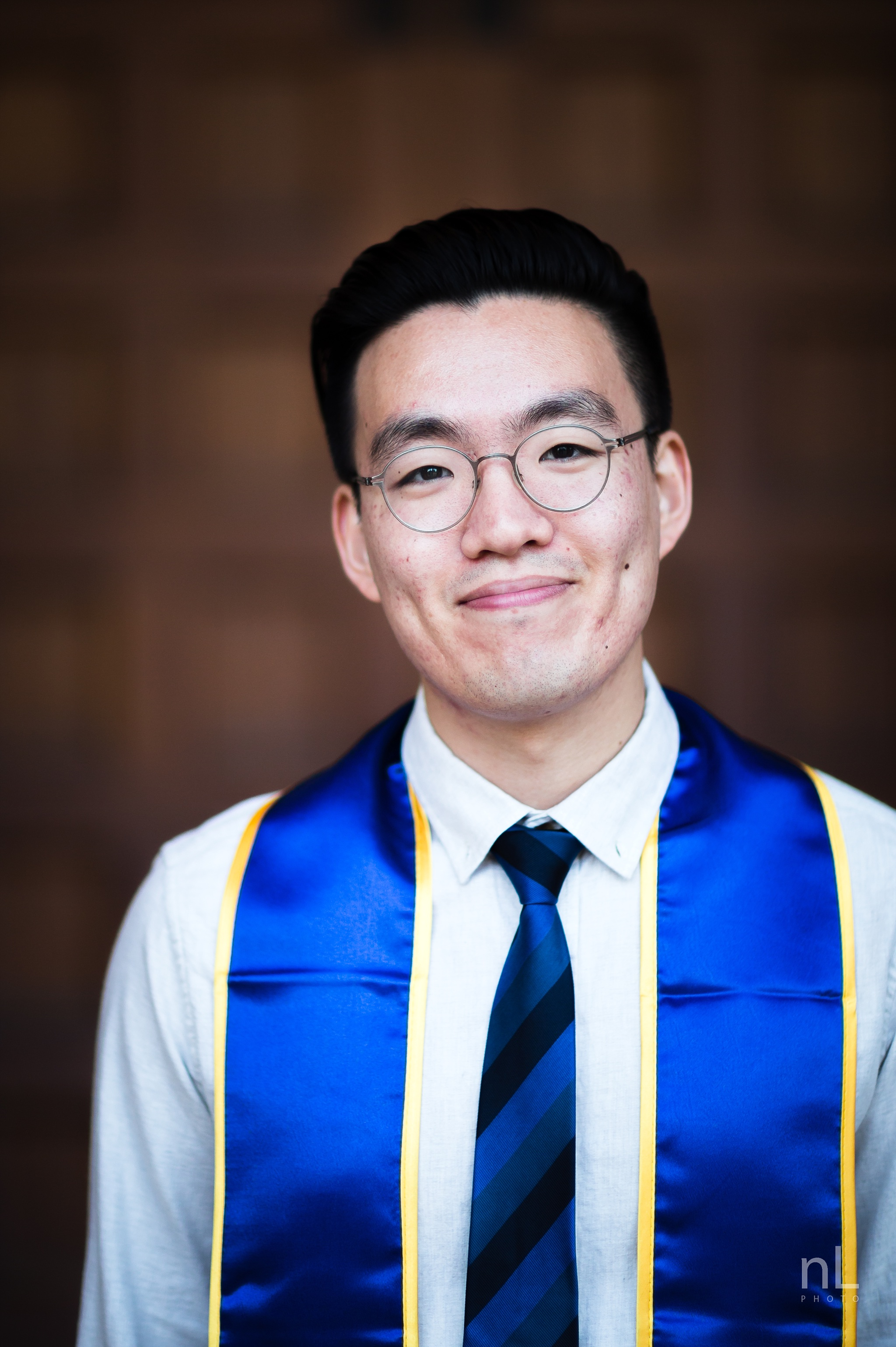 los angeles ucla senior graduation portrait of asian guy at royce front doors