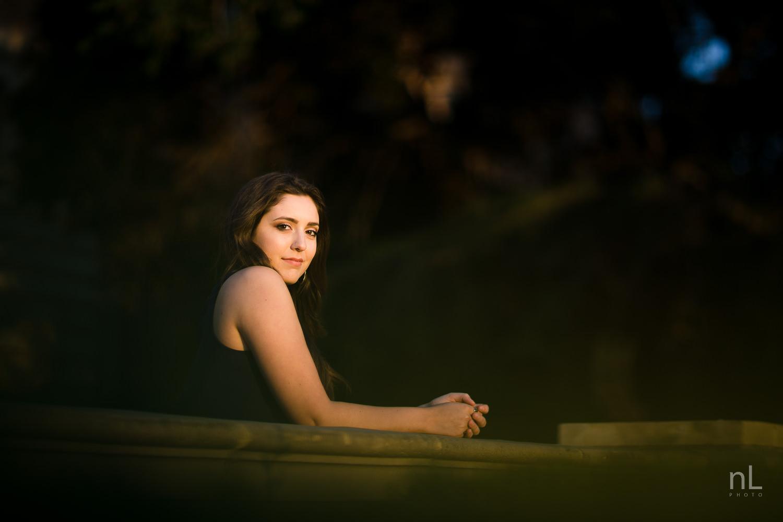 los angeles ucla senior graduation portrait girl in dark dress at sunset with dark moody colors
