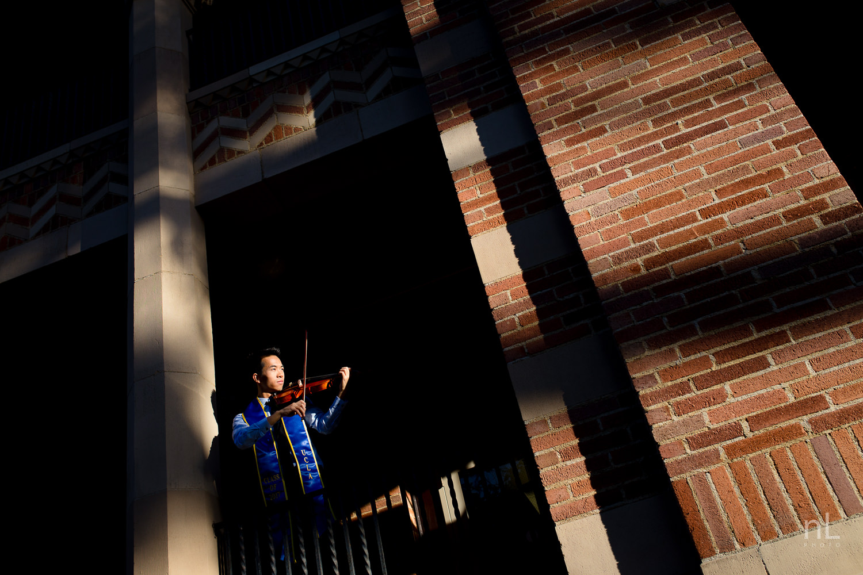 los angeles ucla senior graduation portrait dramatic epic architectural photo of violinist at sunset
