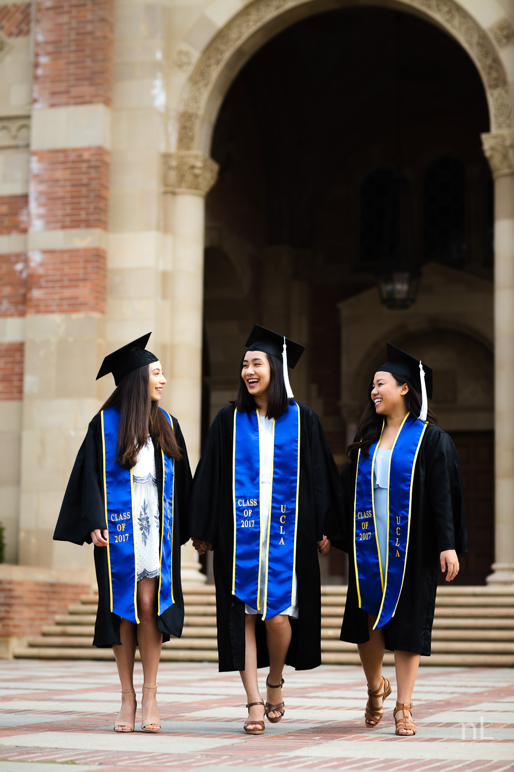 los angeles ucla senior graduation portrait cute smiling laughing best friends at royce hall in caps and gowns