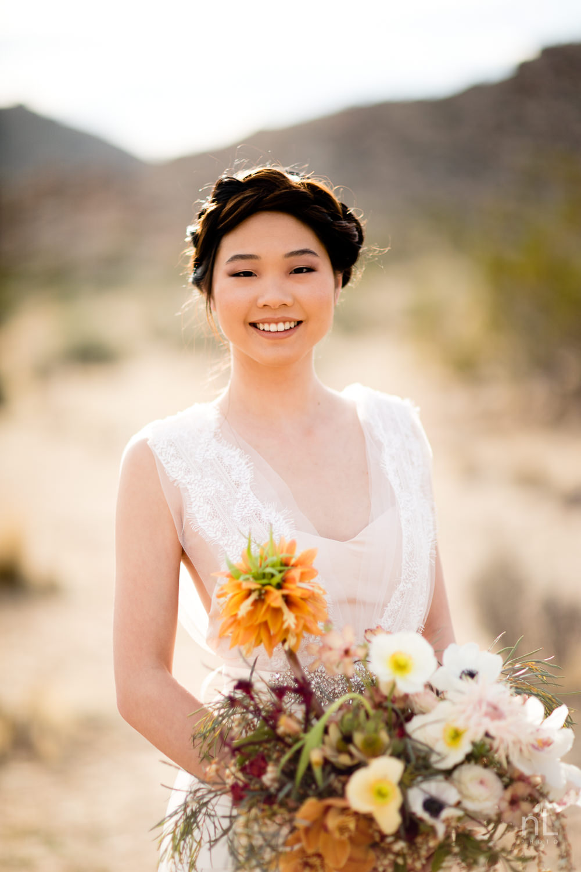 joshua-tree-engagement-wedding-elopement-photography-stylized-photoshoot-bridal-portrait-with-bouquet-dress-and-veil