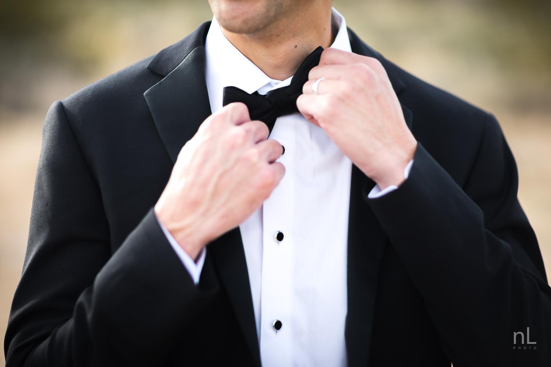 joshua-tree-engagement-wedding-elopement-photography-stylized-photoshoot-groom-adjusting-bow-tie-tuxedo