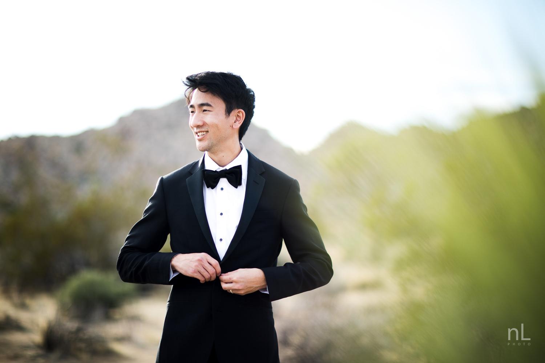 joshua-tree-engagement-wedding-elopement-photography-stylized-photoshoot-environmental-portrait-groom-buttoning-tuxedo