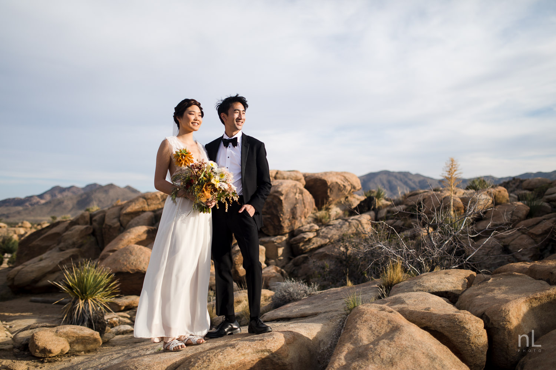 joshua-tree-engagement-wedding-elopement-photography-stylized-photoshoot-bride-and-groom-environmental-portrait-rock-formation