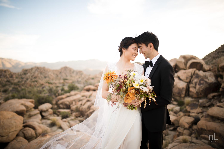 joshua-tree-engagement-wedding-elopement-photography-stylized-photoshoot-epic-environmental-portrait-bride-and-groom-rocks-at-sunset
