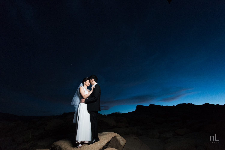 joshua-tree-engagement-wedding-elopement-photography-stylized-photoshoot-epic-environmental-portrait-bride-and-groom-off-camera-flash-blue-hour-dusk