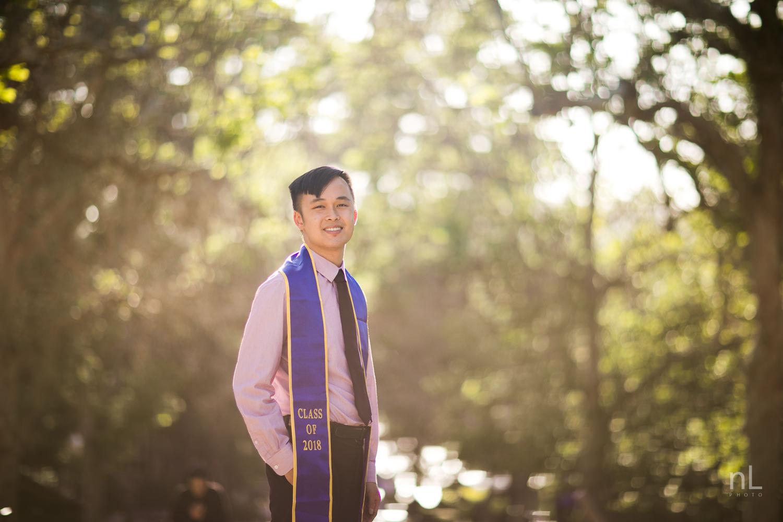 los-angeles-ucla-senior-graduation-portraits-bruinwalk-bokeh-guy-sash-smiling-at-sunset