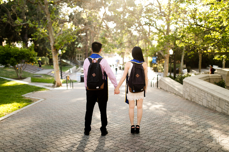 los-angeles-ucla-senior-graduation-portraits-bruinwalk-couple-matching-jansport-backpacks