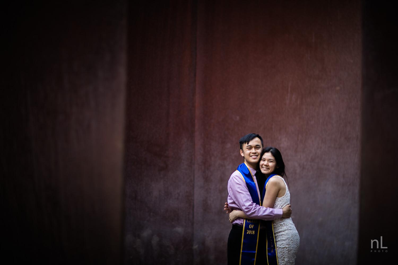 los-angeles-ucla-senior-graduation-portraits-couple-with-sashes-hugging