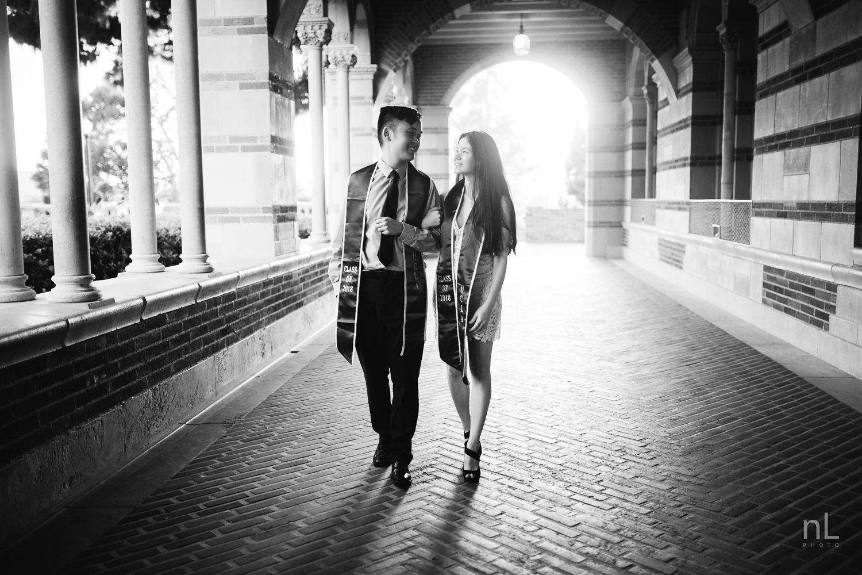 los-angeles-ucla-senior-graduation-portraits-couple-in-royce-hall-black-and-white-walking