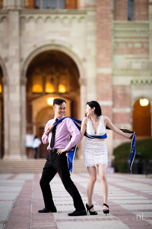 los-angeles-ucla-senior-graduation-portraits-couple-royce-hall-epic-funny-sashes-shot
