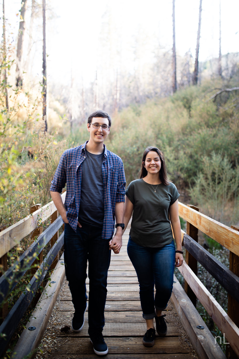 los-angeles-national-forest-engagement-photography-trees-couple-walking-on-bridge-stream