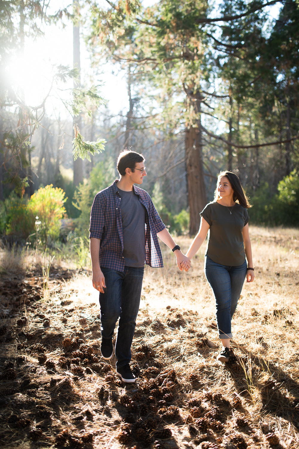 los-angeles-national-forest-engagement-photography-fun-couple-holding-hands-backlight-trees-sunset