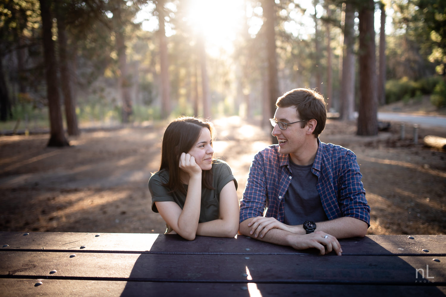 los-angeles-national-forest-engagement-photography-couple-picnic-bench-backlight-trees-sunset