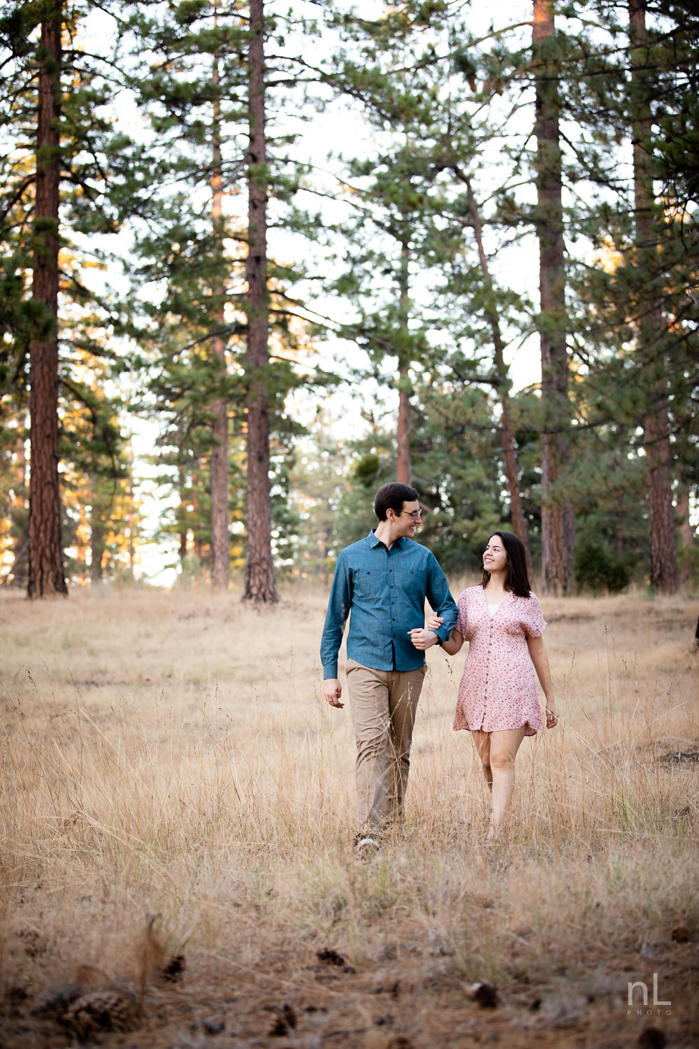 los-angeles-national-forest-engagement-photography-couple-walking-in-wheat-clearing-trees