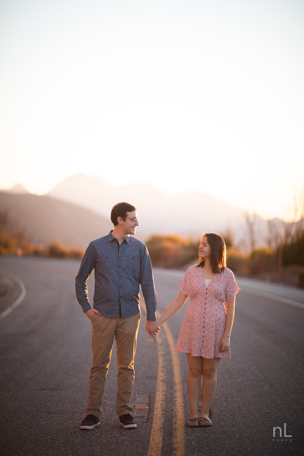 los-angeles-national-forest-engagement-photography-couple-holding-hands-on-road-sunset
