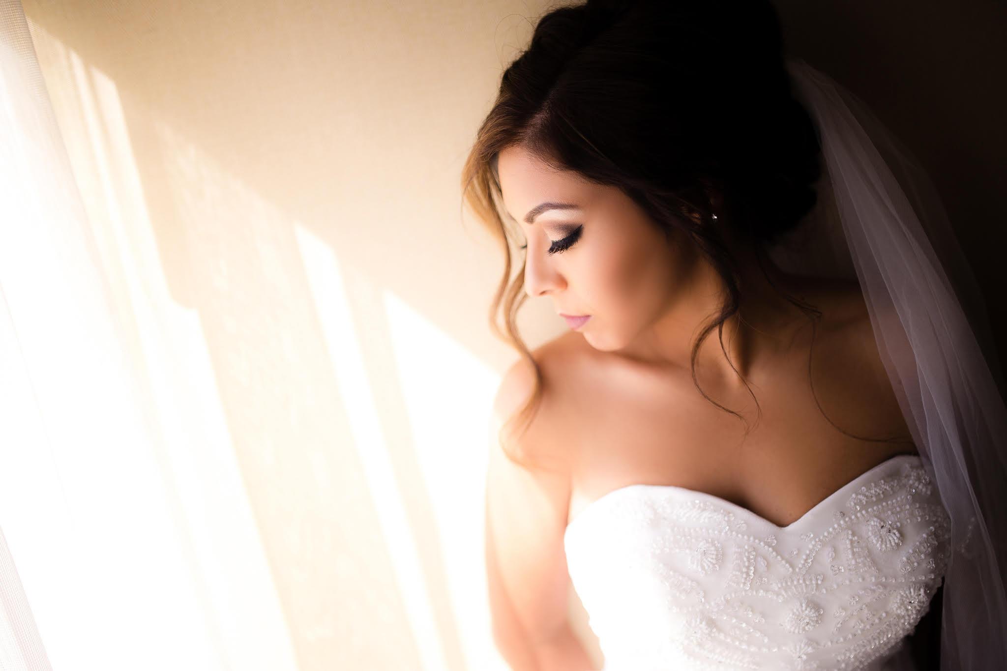 los-angeles-wedding-photography-beautiful-bride-closing-eyes-by-window.jpg