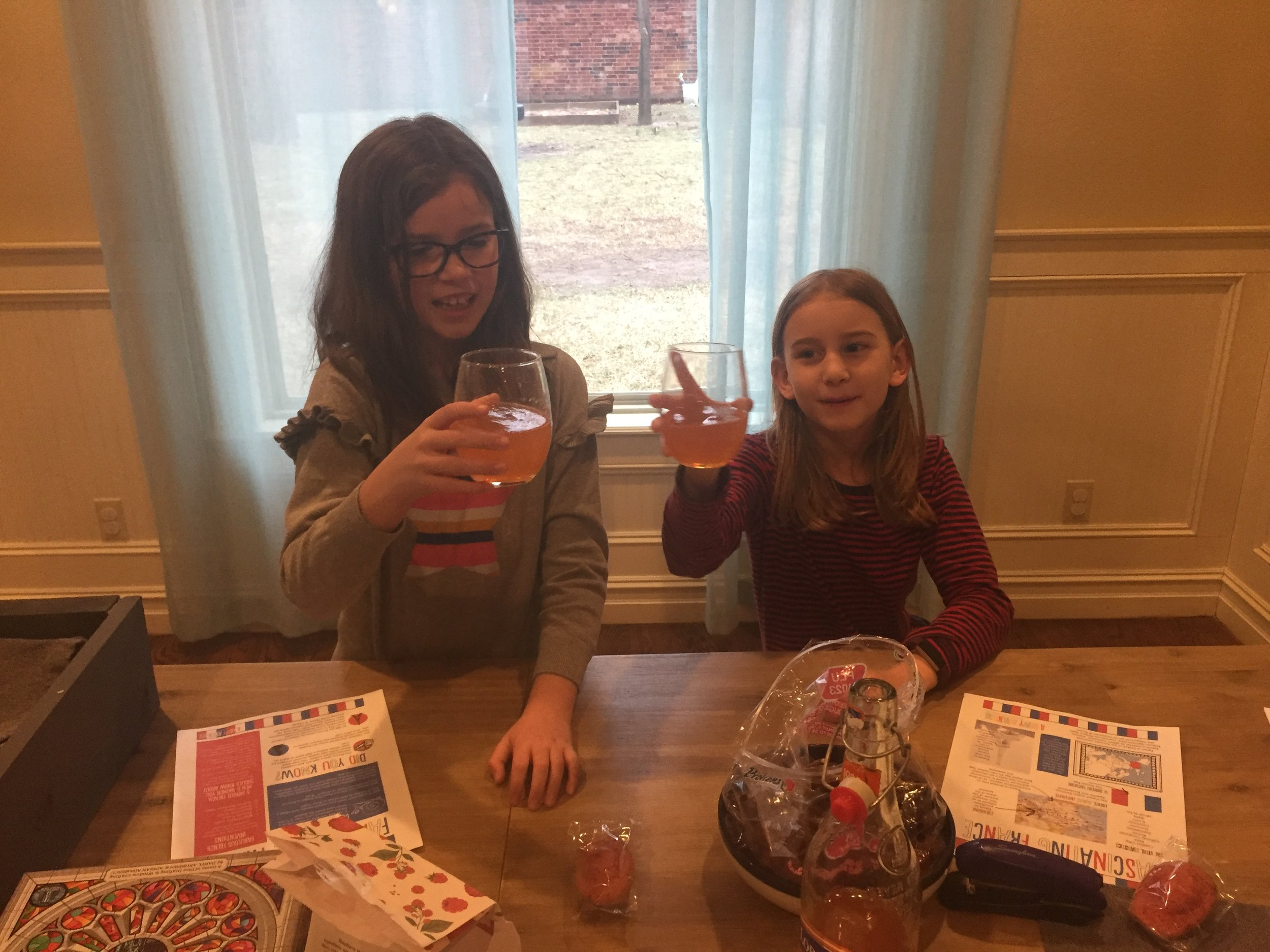 French soda and treats for World Thinking Day =) Abby and Serenity loved drawing paper doll dresses and learning about French Fashion Design.