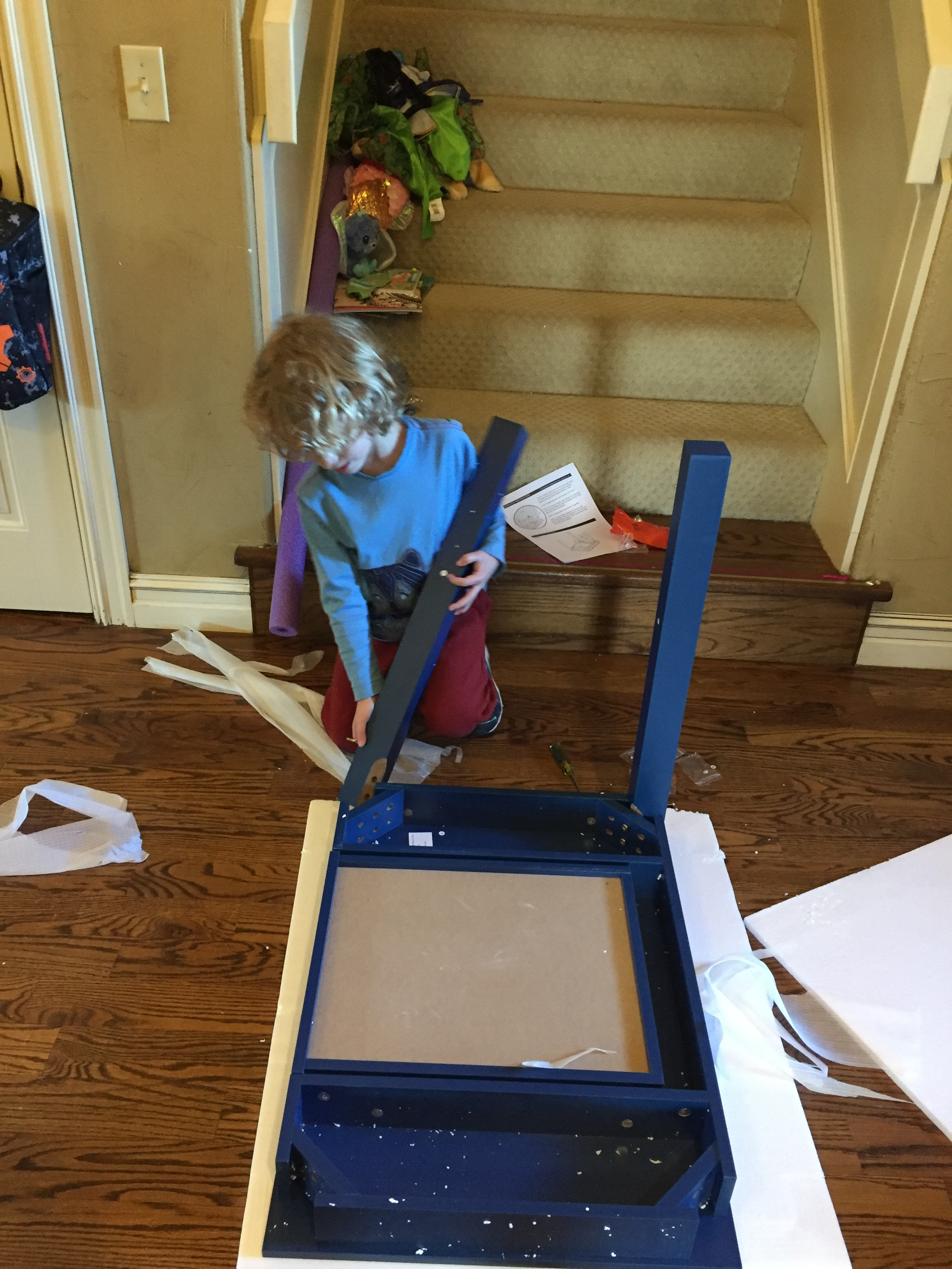 DZ helped assemble some new furniture for his room =)